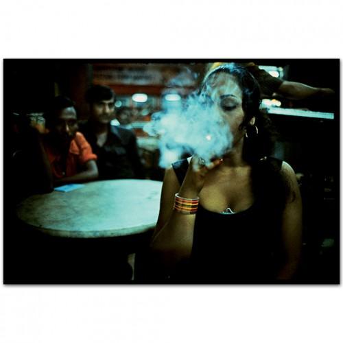 mary ellen mark Transvestite smoking in the Olympia Cafe. Falkland Road, Bombay, India. 1978.jpg