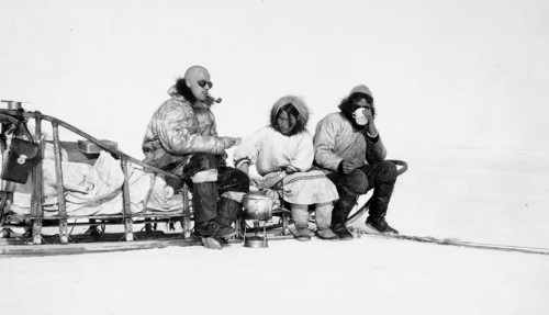 Richard s Finnie, Lucy (Kila Arnaugak) and Bill Storr take a rest during a sled trip across the ice may 1931. .jpg