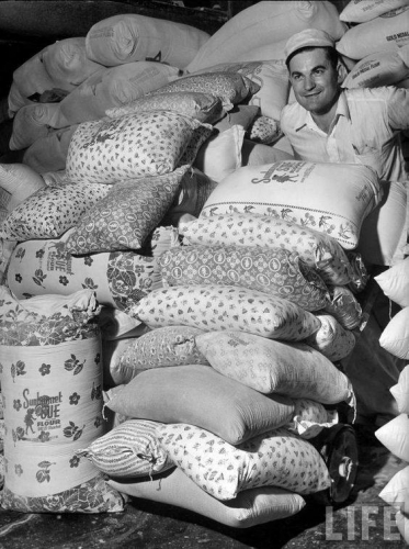 When they realized women were using their sacks to make clothes for their children, flour mills of the 30s started using flowered fabric for their sacks, 1939._n.jpg