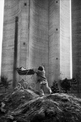 jean gaumy FRANCE. 1971. Seine-Maritime. At the foot of the water tower.jpg