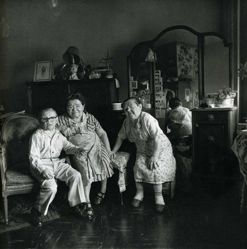 diane arbus-russian-midget-friends-in-a-living-room-on-100th-street-n-y-c-1963.jpg
