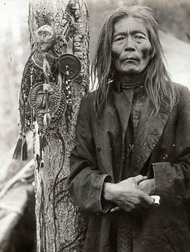 Evenk shaman with a collection of shamanic objects early 1900s..jpg