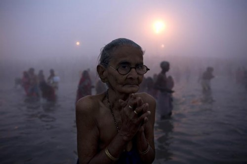 rajesh kumar singh-devotee-morning-prayers-at-sangam.jpg
