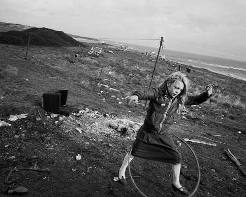 Chris Killip Seacoal Camp, Lynemouth, Northumberland'-helen_and_her_hula_hoop-1984.jpg