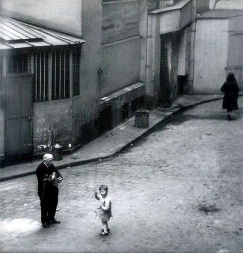 The street musician and the little boy. Paris ca. 1920.n.jpg