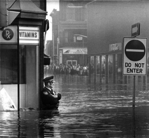 police officer guarding Galt, Ontario pharmacy in waist-high flood waters, May 17, 1974._n.jpg