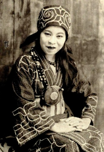 An Ainu woman, one of the indigenous people of northern Japan, in traditional garments, 1890s.jpg
