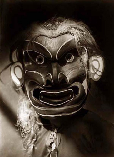 Edward S. Curtis 1914 Kwakiutl mask of mythical creature Pgwis (man of the sea).jpg