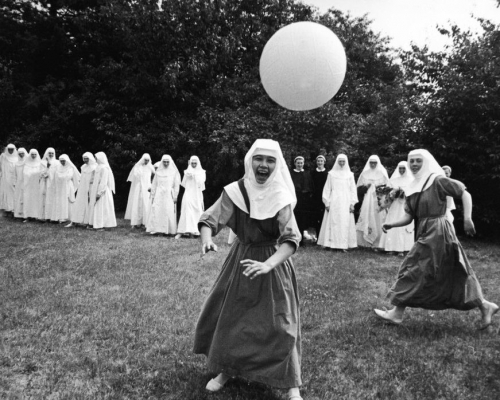 Nuns playing basketball outdoors at the Ladywell Convent, Godalming, England, August 2, 1965.jpg