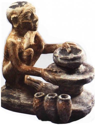 Statuette de bois polychrome représentant un potier égyptien. Début IIème millénaire av. J.-C. .jpg