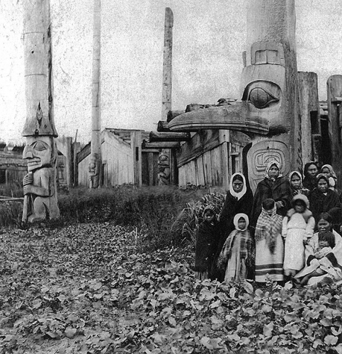 Edward Dossetter Women and children of Yan in front of Flicker House and a memorial pole to an Eagle chief, Ildjiwas .jpg