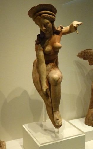 Terracotta figurine of Aphrodite removing her sandal. Votive offering from the Sanctuary of the Mother of the Gods and Aphrodite, Pella. Late 4th – early 1st c. BC..jpg