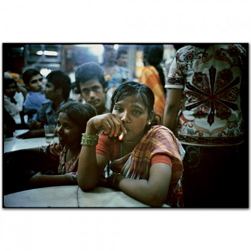 mary ellen mark A young street prostitute in the Olympia Cafe. Falkland Road, Bombay, India. 1978.jpg