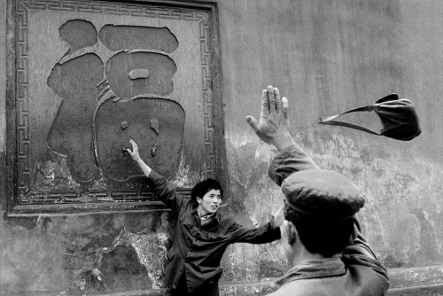 Guy Le Querrec A flying handbag at a monastery in Xindu, China, April 1984.jpg