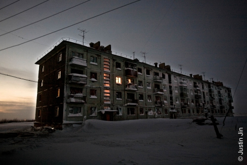 Justin-Jin-Lights shine from the last occupied flat in an apartment block in Komi.jpg