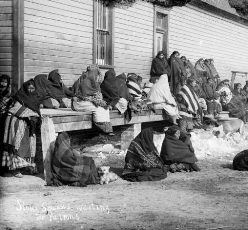 Sioux Women Waiting for Rations at Pine Ridge Reservation, 1891.jpg