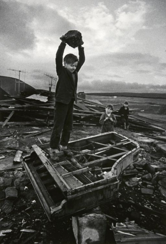 Philip Jones Griffiths Boy Destroying Piano, Wales, 1961.jpeg