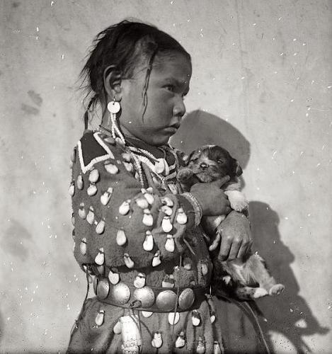 Richard Throssel Blanket Bull's daughter with puppy. Crow. Early 1900s.jpg