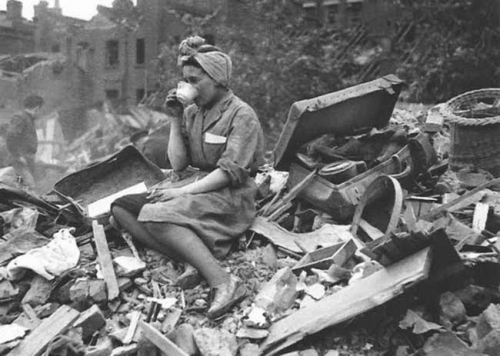 A woman drinking tea in the aftermath of a German bombing raid during the London Blitz, 1940..jpg