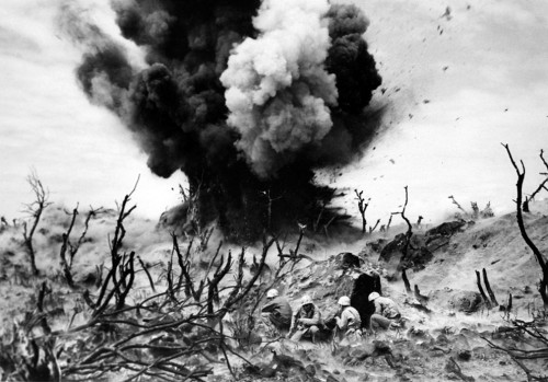 William Eugène SmithMarine Demolition Team Blasting Out a Cave on Hill 382 Iwo Jima 1945.jpg