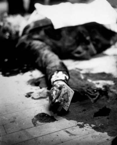 1931 Mafia boss Joe Masseria lays dead on a Brooklyn restaurant floor holding the ace of spades..jpg