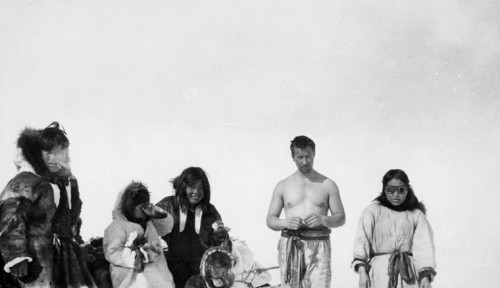richard s finnie [second from right, sunbathing] and Inuit driving dogs.  Coronation Gulf, N.W.T. [Nunavut] may 1931.jpg