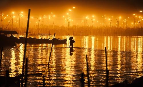 Konstantino Hatzisarros hindu pilgrim walking_on_the_waterin kumbhmela india.jpg