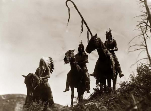 Edward S Curtis  Uphaw, Which Way, and an unidentified Crow Indian on horseback. Crow War party 1905.jpg