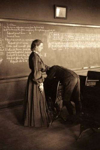 A school teacher lashing a boy student over a desk, Menomonie, Wisconsin, 1905_n.jpg