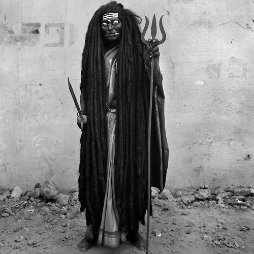 Yannick Cormier A man dresses as the goddess Kali to bless the people of the village. .jpg