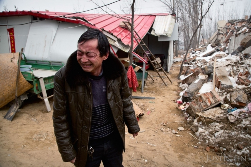 justin-jin-A farmer in Zhengzhou city, Henan, in front of his house after it was torn down for redevelopment..jpg