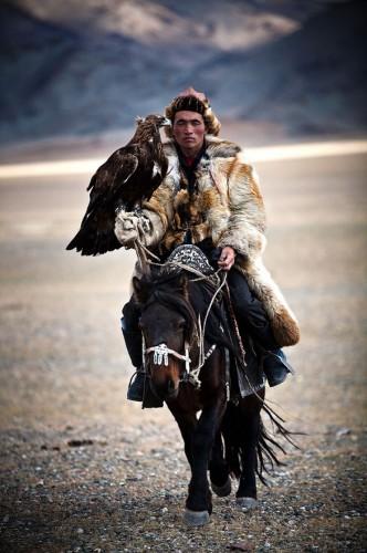 VIACHESLAV SMILYK A Mongolian hunter on a horse with a golden eagle.jpg