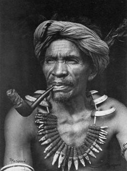 Eduardo Masferré Respected elder Lakay Kabayo, wearing his Buaya (ceremonial necklace) with boar, dog and crocodile teeth in woven rattan. Sagada, Mountain Province 1950.jpg