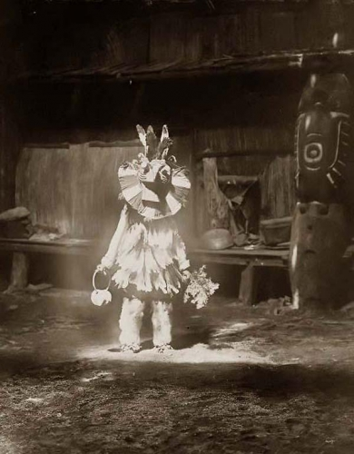 Edward S. CurtisMasked Dancer Cowichan 1913..jpg