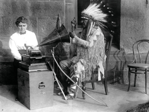 Frances Denmore Recording an Indian Man.jpg