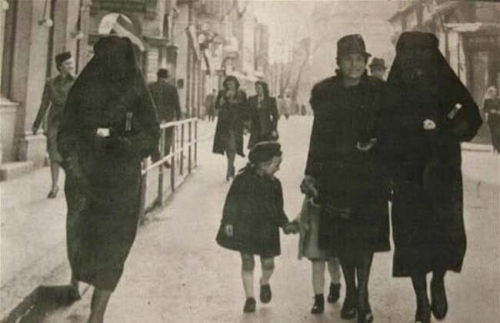 A Muslim woman covers the yellow star of her Jewish neighbor with her veil to protect her from prosecution. Sarajevo, former Yugoslavia, 1941..jpg