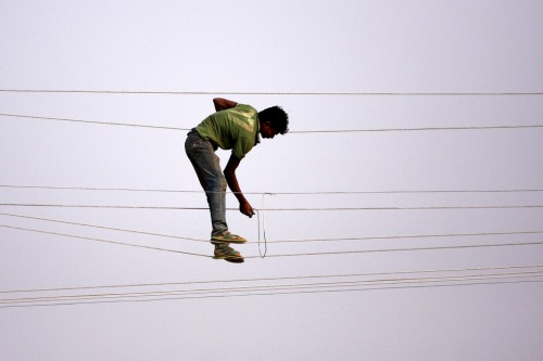 Sanjay Kanojia A utility worker made adjustments to power lines in Allahabad, India, Sunday. .jpg