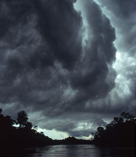 mike goldwater Dark monsoon clouds gather over the Envira River in Acre Province, Brazil.jpg