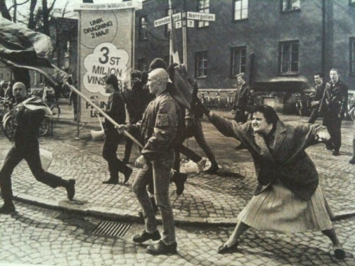 A Swedish woman hitting a neo-Nazi protester with her handbag. The woman was reportedly a concentration camp survivor, 1985.).jpg