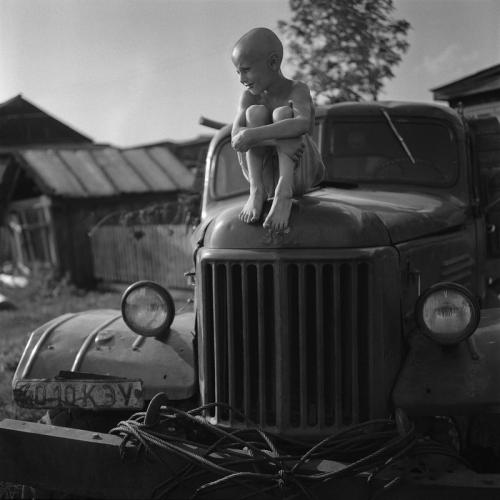Alexander Kustov  A boy named Zahar sits on an old car in Rossiyka near Krasnoyarsk .jpg
