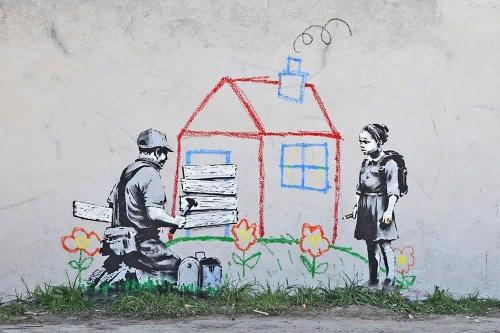 Banksy_cande_la.jpg